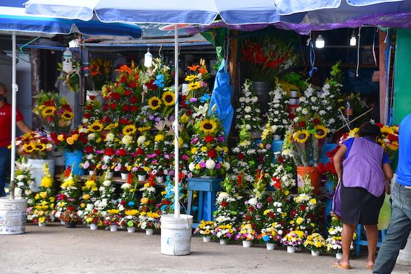 fresh flower arrangements in the local mercado in Merida Mexican