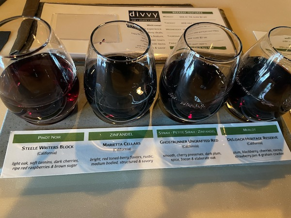 flight of red wines at divvy a unique eatery in Carmel Indiana
