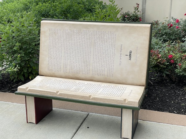 book shaped bench along the Monon Trail