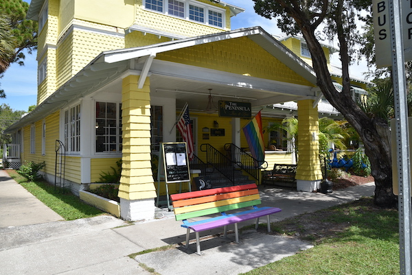 rainbow bench and flag outside hotel in Gulfport Florida