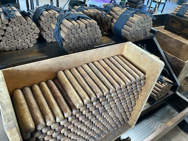 stacks of hand rolled cigars in the JC Newman Cigar Company factory
