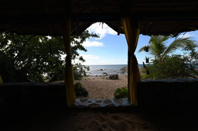 The view of the beach from the bed in the chalet