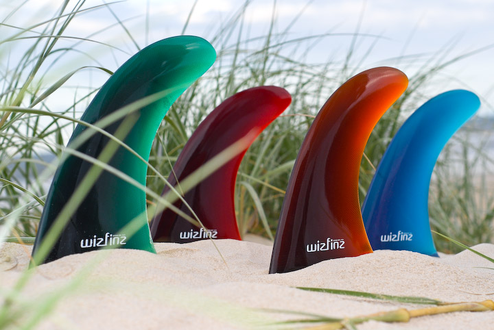 Surfboard fins placed in sand for commercial photo shoot