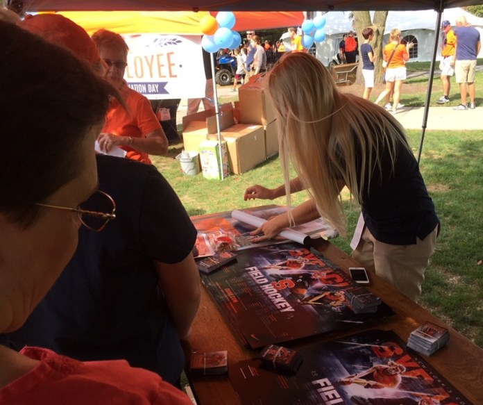 The Orange field hockey squad passes out posters.
