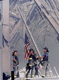 firemen raise flag