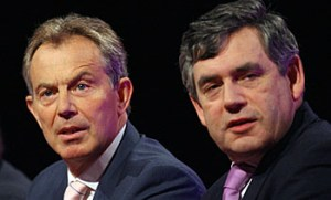 British Prime Minister Tony Blair (L) an