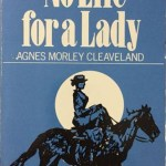 Book cover with full moon silhouetting a woman riding a horse on a side saddle.