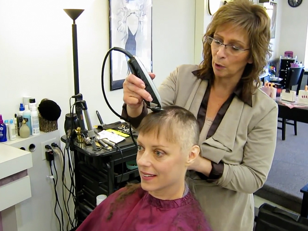 Head shaving during breast cancer: Amy Czerniec with Joni Haarbauer at The Hair Co., Kenosha, Wisconsin