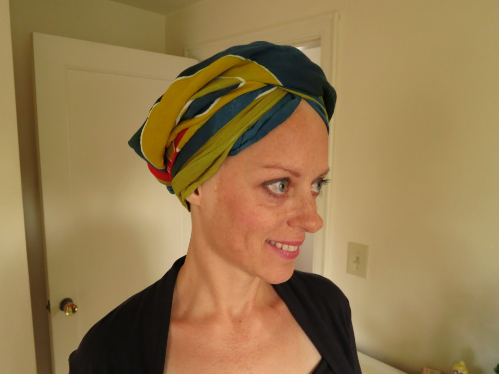 Breast cancer patient Amy Czerniec modeling a head wrap during chemotherapy