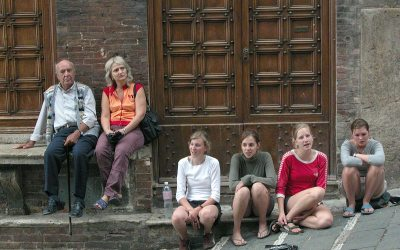 Four young women singing, Siena, Italy