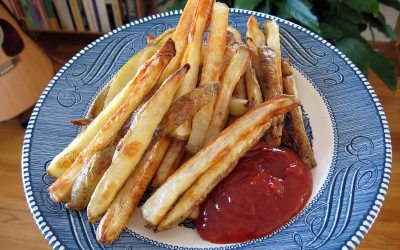 Hot oven fries on a plate, with ketchup