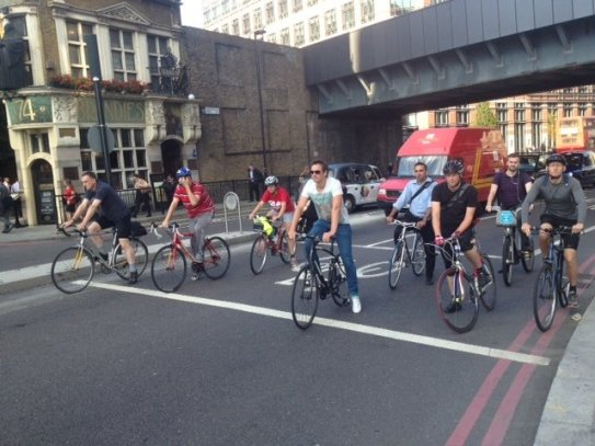 Rush_hour_cyclists_in_the_City_of_London,_August_2013