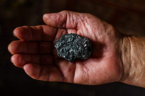 U.S. coal industry - piece of coal in miners hand pixabay-1521718
