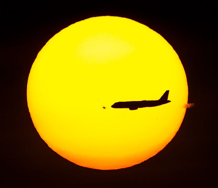 Huge Sunspot AR665 with airplane in sky