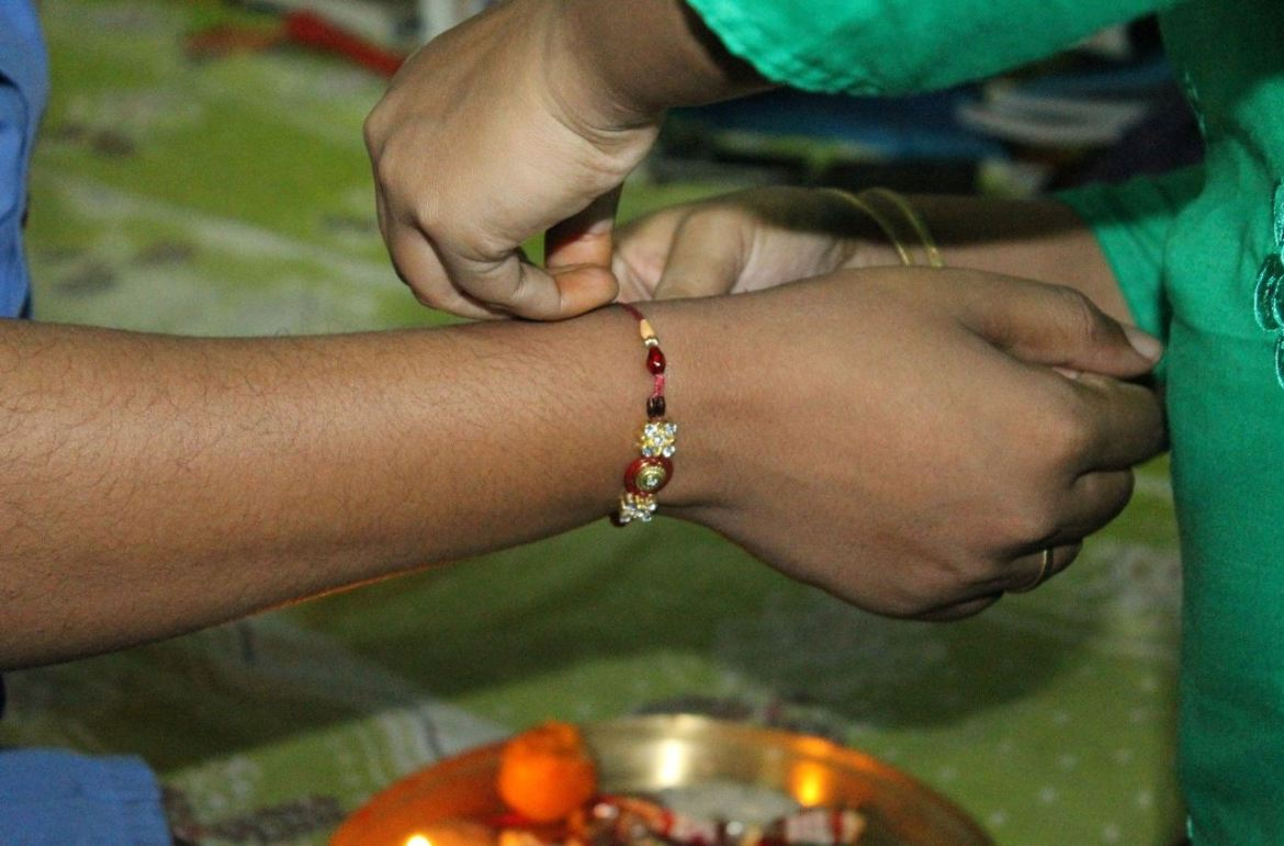 A rakhi gift being tied image 444