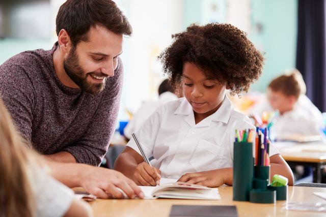 Teacher helps student writing