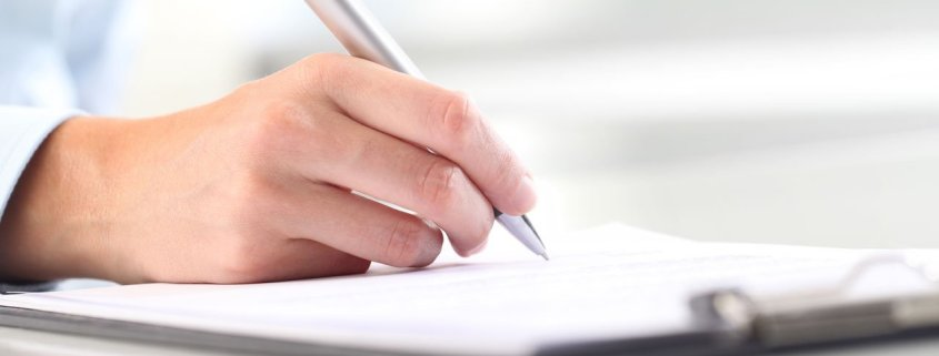 Image of womans hand writing for three step writing process