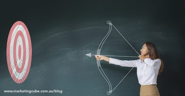 Businesswoman with bow and arrow