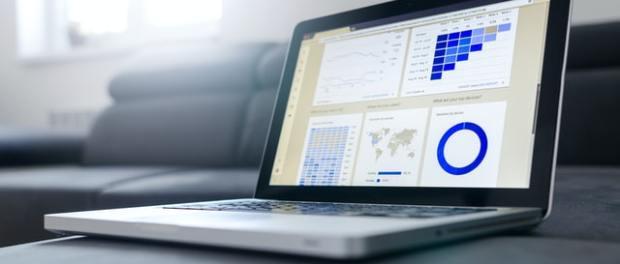A laptop displaying statistics