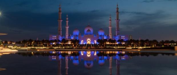 A dusk and twilight shot of the Grand Mosque at Abu Dhabi, United Arab Emirates.