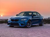 A BMW on a beach.