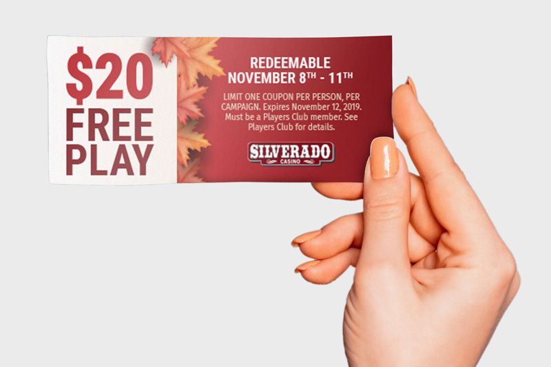 Person holding $20 Free Play coupon for Silverado Casino