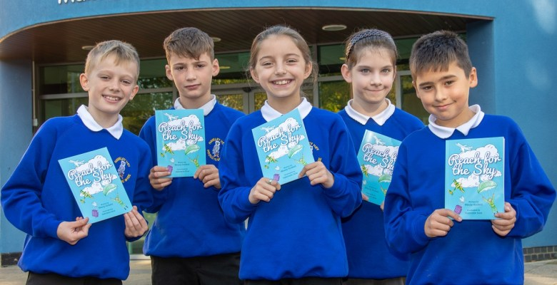 Local school children with the first copies of Reach for the Sky