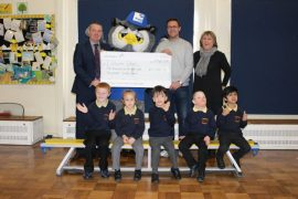 Arena Group Nick Pendlebury presents cheque to Lisburne School