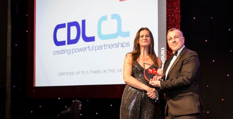 HR Manager Emma Lord collects Top Employers trophy at the ceremony on behalf of the Stockport Tech Firm CDL