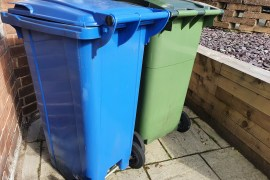 Green and blue waste bins in Stockport
