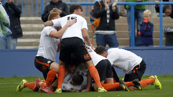 Stockport County's players celebrate their late winner