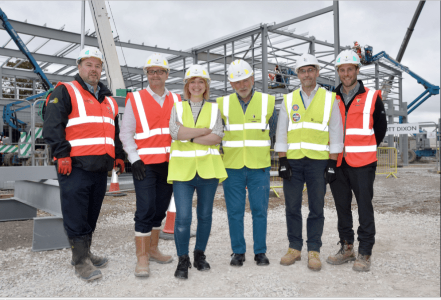 Mike Lane (Operations Director at Willmott Dixon), Anthony Dillon (Managing Director at Willmott Dixon), Cllr Becky Crawford, Cllr Chris Murphy, Peter Fox (Head of Projects at Carillion) and Phil Lavers (Building Manager at Willmott Dixon).