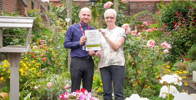 Pictured: Last year's winner of 'Best in the Borough', Mrs Jean Simpson of Edgeley, (right) being presented with her award by Stockport Homes' Greenspace Manager Tony de-Beaufort.