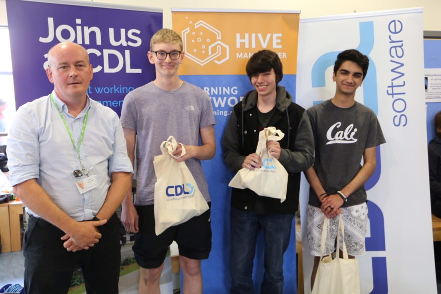 CDL HR business partner Tom McConnell with the winners of the first Great Manchester College Hackathon, Team Undecided, from Altrincham Grammar School for Boys