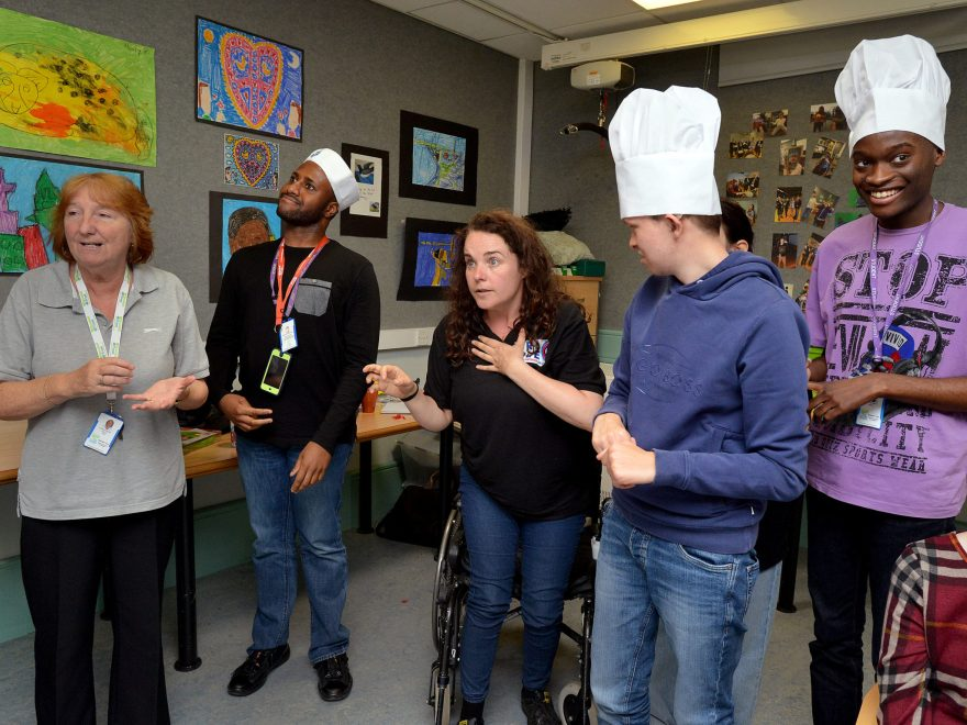 Christine Caddick, an learning support assistant watches as Royal College Manchester students Shaquille Omonijo-Awofulu, 22, from Manchester, Dan Follon, 21, from Halton, and Khalil Mongeme, 20, also from Manchester taken part in a TripleC workshop with Coronation Street star Cherylee Houston.