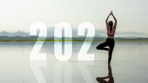 Woman in yoga pose and the year 2021