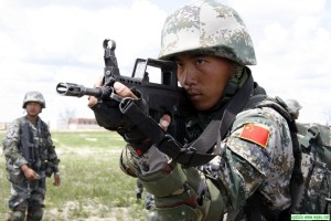 Not your father's People's Liberation Army, modern Chinese Special Forces solider with weapons.