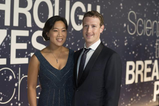 An out of character Mark Zuckerberg with his wife Priscilla Chan.