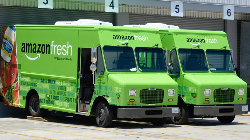 INGLEWOOD, CA - JUNE 27:  Amazon Fresh trucks sit parked at a warehouse on June 27, 2013 in Inglewood, California. Amazon began groceries and fresh produce delivery on a trial basis to select Los Angeles neighberhoods free of charge for Amazon Prime members. AmazonFresh lets you order groceries and have them delivered on the same day.  (Photo by Kevork Djansezian/Getty Images)