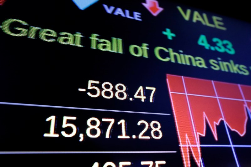A screen on the floor of the New York Stock Exchange shows the closing number for the Dow Jone industrial average, Monday, Aug. 24, 2015. U.S. stocks closed sharply lower, with the DJIA down more than 588 points. (AP Photo/Richard Drew)