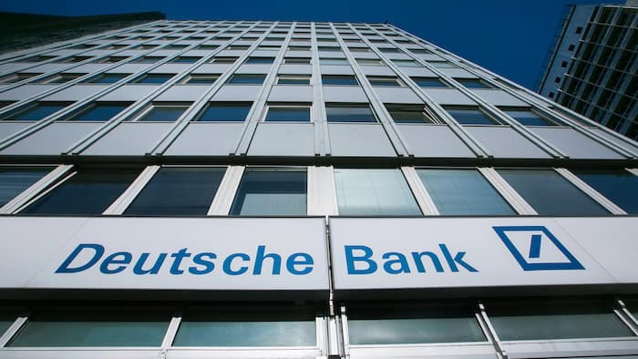 The logo of Deutsche Bank AG sits on the exterior of a bank branch in Berlin, Germany, on Monday, Oct. 12, 2015. Deutsche Bank co-Chief Executive Officer John Cryan may eliminate a dividend that's stood since Germany's postwar reconstruction as he tries to overhaul the firm without asking shareholders for more capital. Photographer: Krisztian Bocsi/Bloomberg
