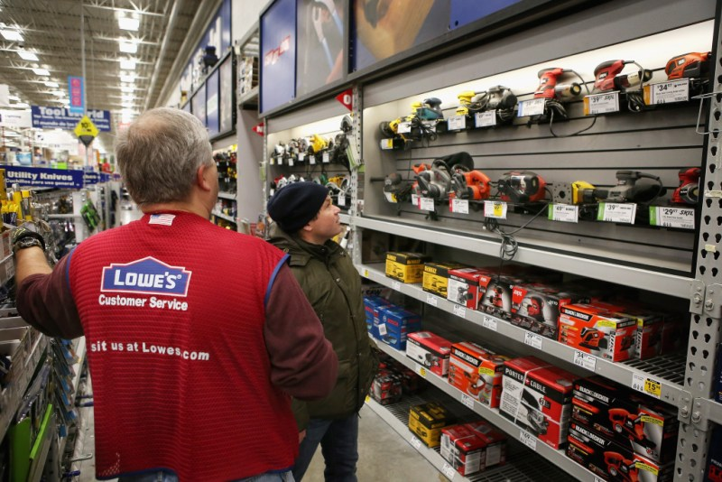 CHICAGO, IL - JANUARY 24: Wes Bielinski (L) helps a customer shop for a sander at a Lowe's home improvement store on January 24, 2013 in Chicago, Illinois. Lowe's said they plan to hire 45,000 part-time workers this spring, the busiest time of the year for home improvement retailers. The company also expects to hire 9,000 permanent part-time employees. (Photo by Scott Olson/Getty Images)
