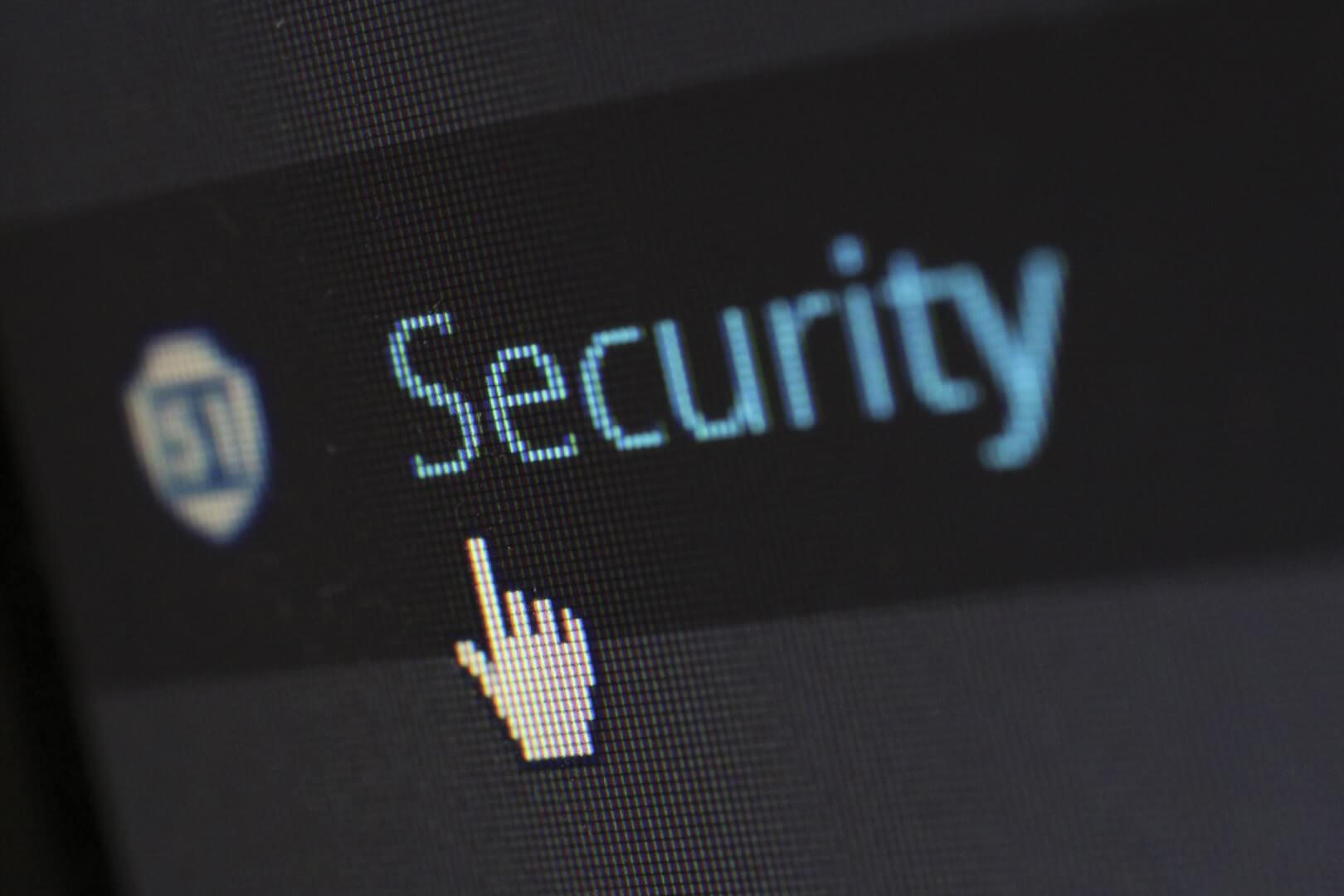 "picture of a computer cursor hovering over a button entitled ""Security"""