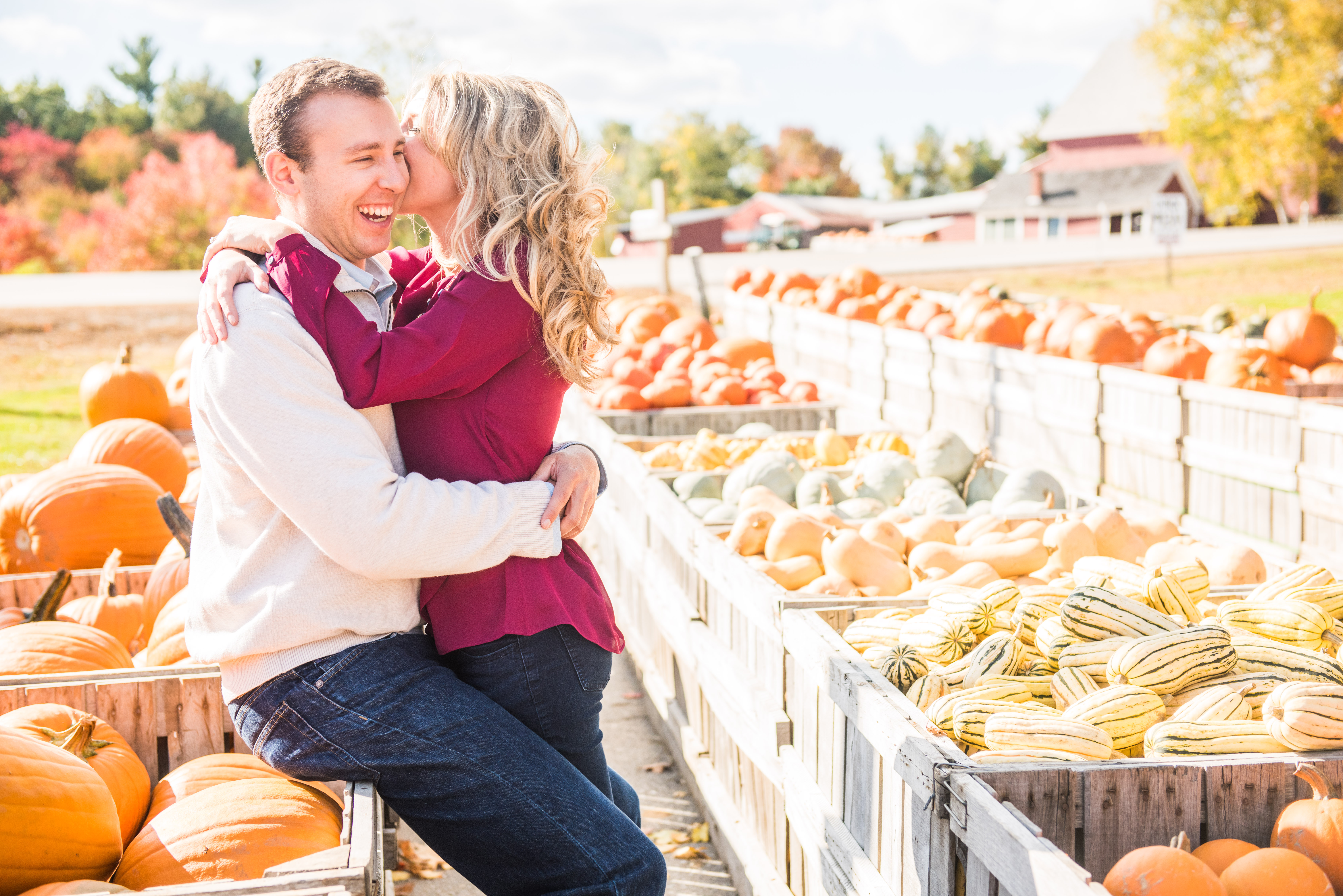 Fall engagement photo of couple at pumpkin patch