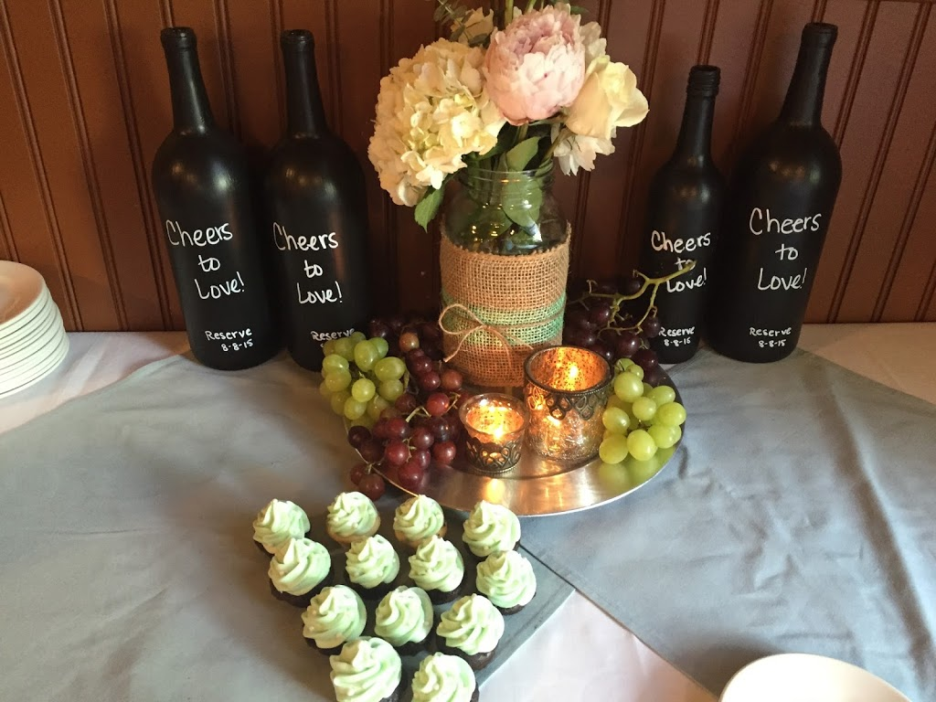 Wine-themed table centerpieces and desserts for a wine-themed summer bridal shower