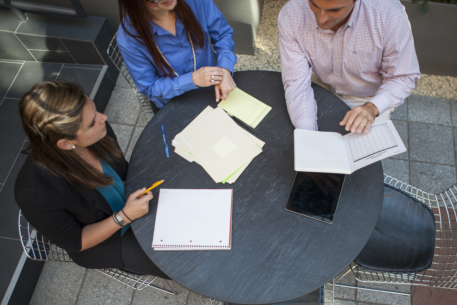 Photo showing a work meeting which illustrates the role of an account handler in an agency