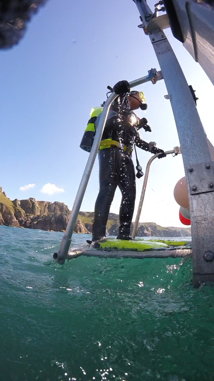Diver lift on a dive boat at Lundy Island
