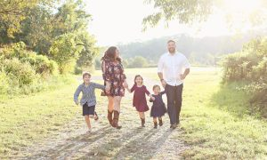 Mark L. O'Brien, his wife Maria, and their three children.