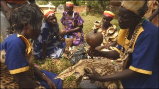 Former witch-doctors demonstrate an initiation ceremony in Lira in the northern region of Uganda