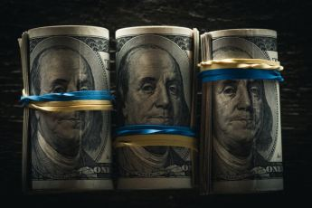 The real value of money - rolled up bills